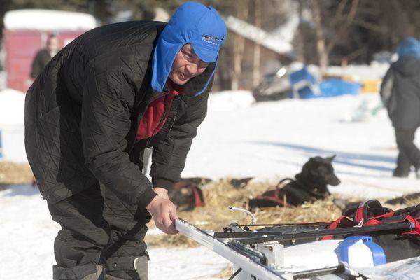 John Baker changes the runners of his sled in Anvik.