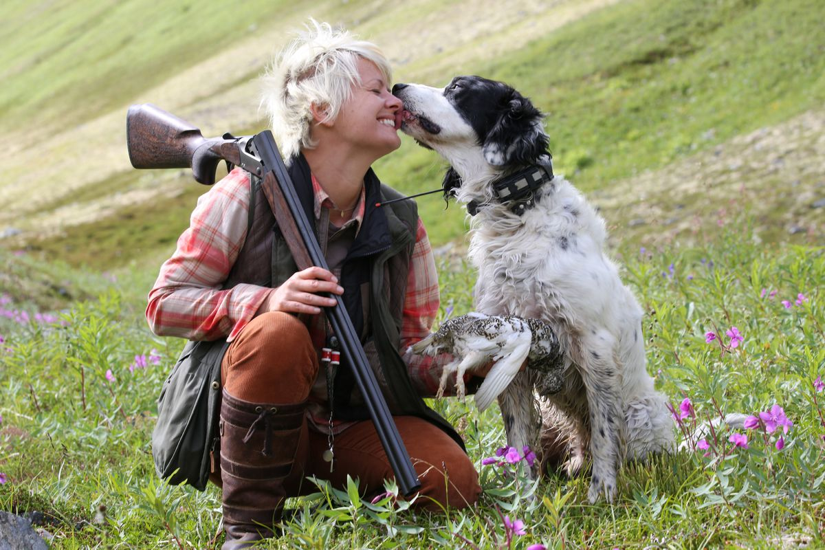 Christine Cunningham and Winchester thanking each other for one of this year's rare opportunities to take a whitetail ptarmigan on Aug. 10.. (Photo by Steve Meyer)