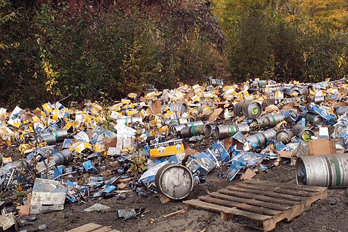 Beer containers litter the side of the road at Mile 106 of the Glenn Highway following a truck accident Tuesday morning, Sept. 13, 2016, near Caribou Creek and the Matanuska Glacier. (Courtesy Matanuska-Susitna Borough)
