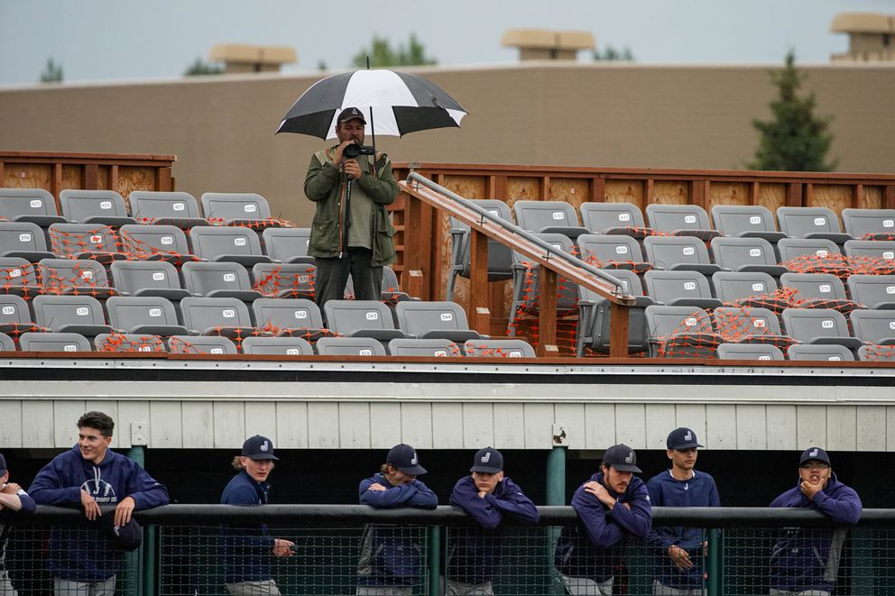 A spectator films the action at Mulcahy Stadium. (Loren Holmes / ADN)