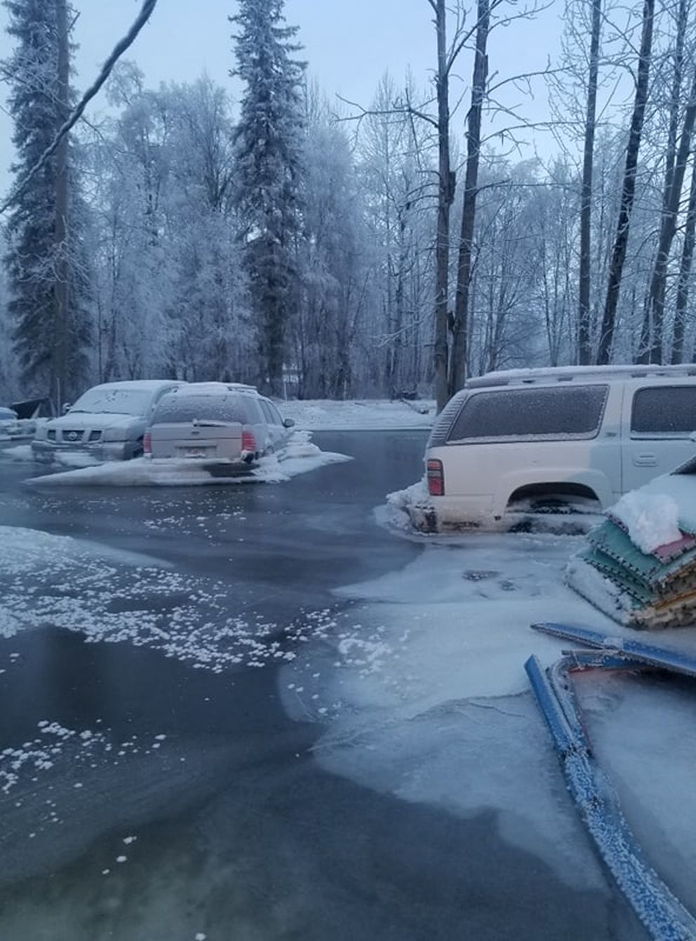 Vehicles were frozen in Kevin Vance's front yard after an ice jam at the Deneki bridge caused flooding in nearby Willow neighborhoods on Dec. 22, 2019. Photo by Kevin Vance.