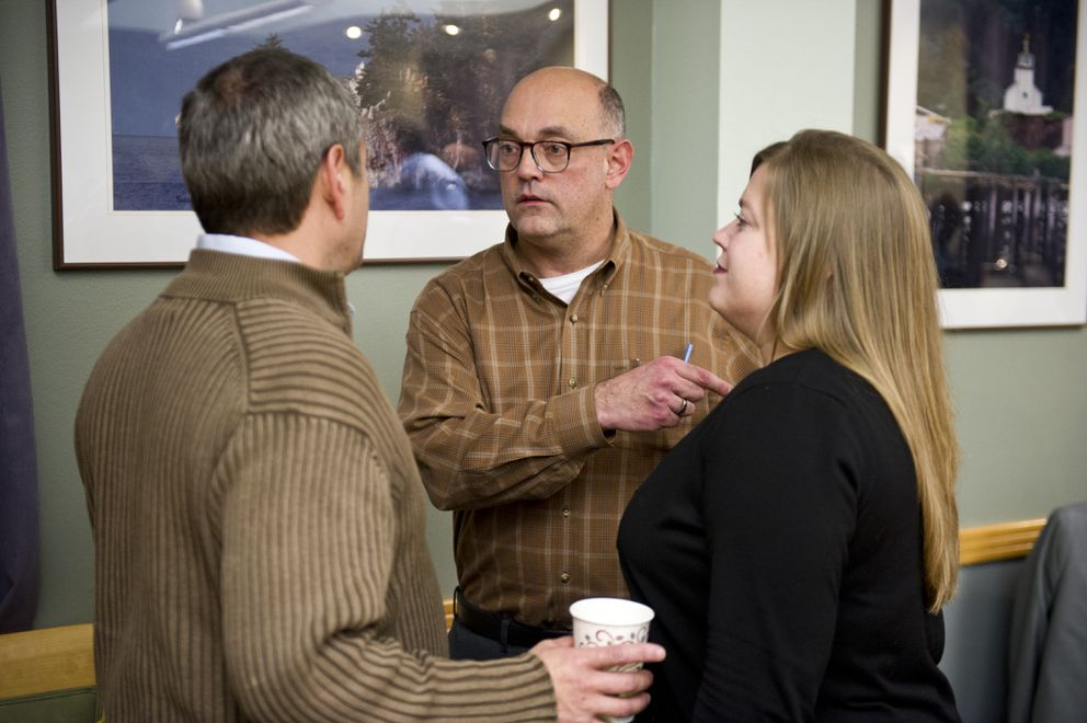 Rep. Andy Josephson, D-Anchorage, center, talking to two other legislators in a file photo from 2016. (Marc Lester / Alaska Dispatch News)