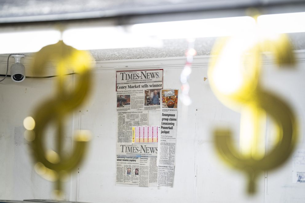 Newspaper clippings about the lottery jackpot hang at Coney Market. Washington Post photo by Jabin Botsford.