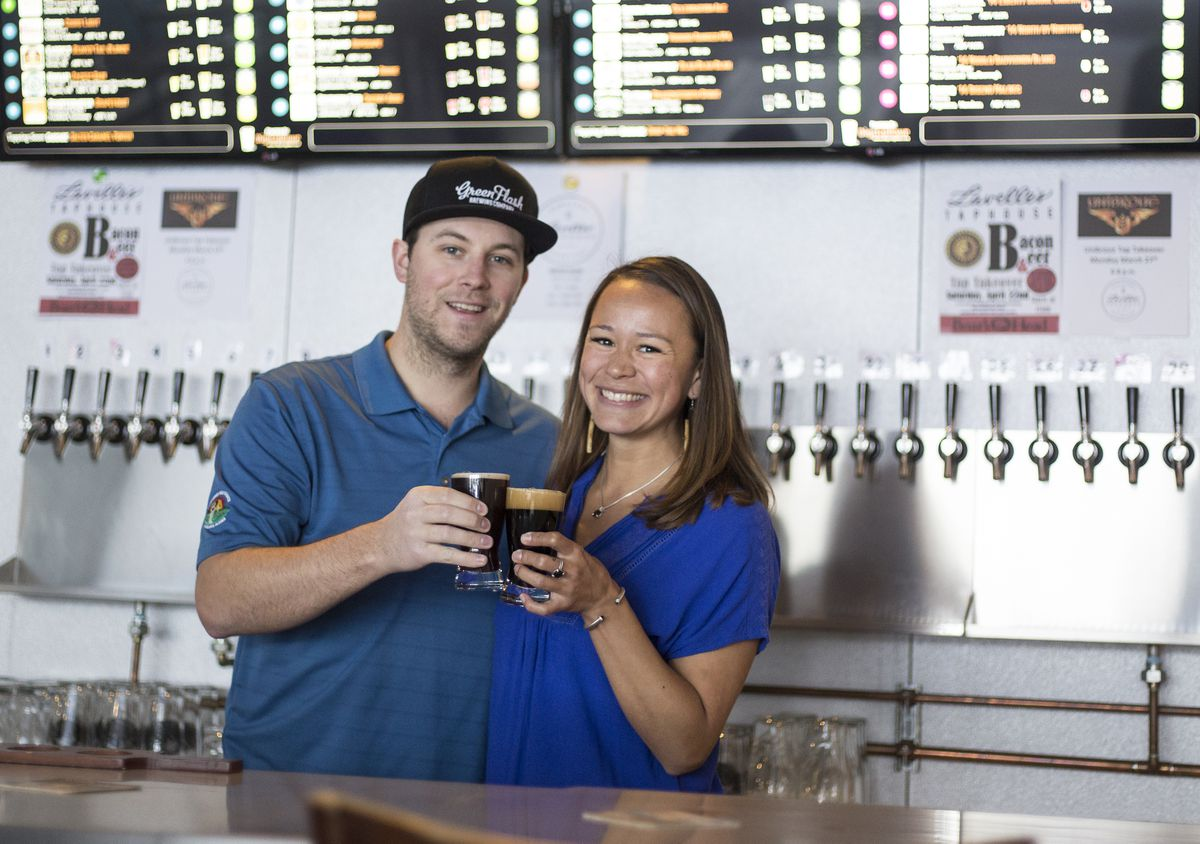 Brett Swanson and Arlette Eagle-Lavelle, owner of Lavelle's Taphouse, show some of their product in downtown Fairbanks. (Rugile Kaladyte / Alaska Dispatch News)