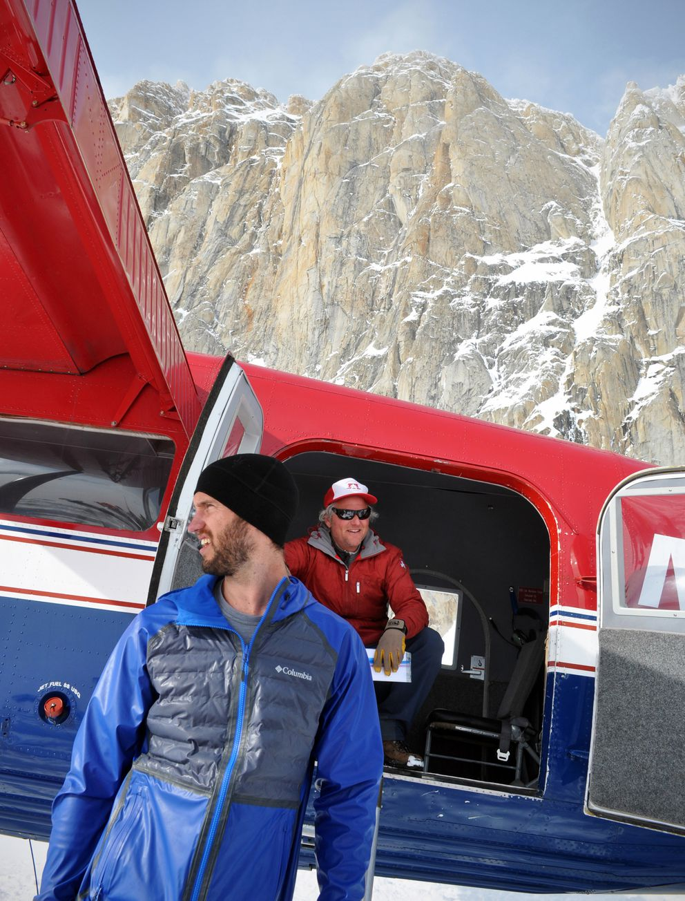 Matt Cress, left, helps Talkeetna Air Taxi operations director and pilot Paul Roderick unload a de Havilland Otter on Sunday, May 12, 2019. (Vicky Ho / ADN)