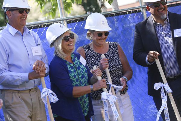 From left, Alaska Mental Health Trust CEO Mike Abbott, Cook Inlet Housing Authority President/CEO Carol Gore, Covenant House Alaska Executive Director Alison Kear and Weidner Apartment Homes Vice President Government Affairs Greg Cerbana break ground where a new apartment building will be located next to Covenant House Alaska's Youth Engagement Center. The new program, Bridge to Success, aims to provide young adults ages 18-24 with housing after transitioning from a shelter. The event was hosted by Covenant House Alaska and Cook Inlet Housing Authority in Anchorage on Tuesday, June 29, 2021. (Emily Mesner / ADN)