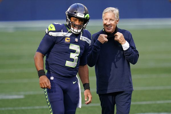 Seattle Seahawks quarterback Russell Wilson (3) talks with head coach Pete Carroll before an NFL football game against the New England Patriots, Sunday, Sept. 20, 2020, in Seattle. (AP Photo/Elaine Thompson)