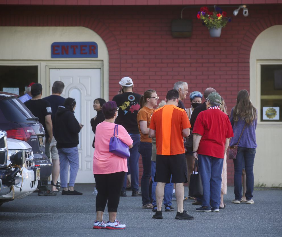 People form a line outside the entrance to Kriner's Diner in Anchorage before it opened at 9 a.m. on Aug. 5, 2020. (Emily Mesner / ADN)