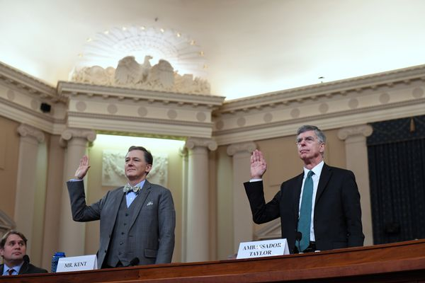 George Kent, left, and William Taylor, right, are sworn in for a House Intelligence Committee impeachment hearing on Nov. 13, 2019 in Washington, DC. MUST CREDIT: Washington Post photo by Matt McClain