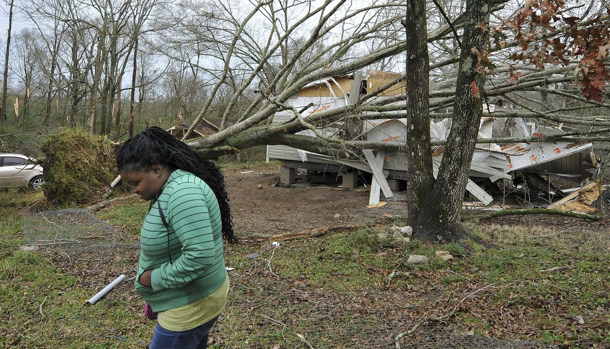 Atalaya Price, of Edwards, walks by what's left of her new mobile home after a tornado ripped through her neighborhood around noon, Monday, Dec. 16, 2019, in Edwards, Miss. Price and her four children, none of whom were at home when the storm hit, moved in just two weeks earlier. (Barbara Gauntt/The Clarion-Ledger via AP)