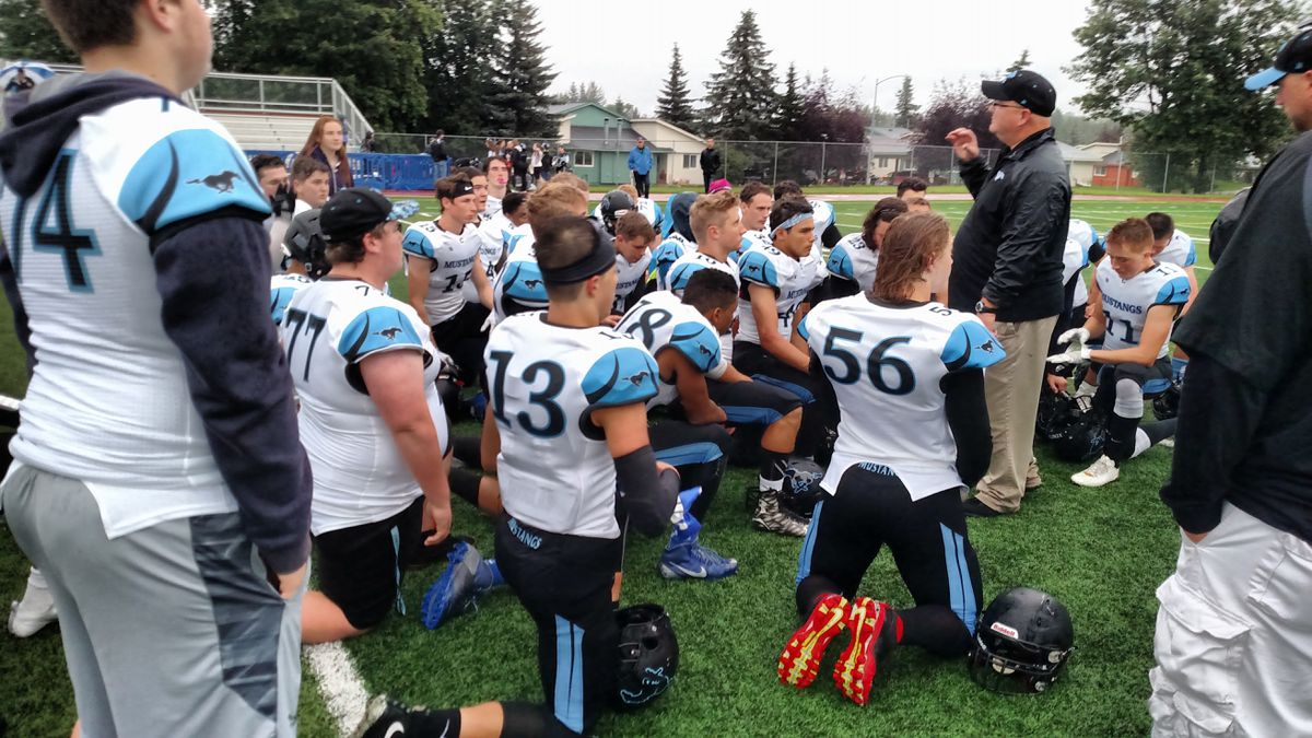 The Chugiak Mustangs listen to coach Roger Spackman. (Photo by Stephan Wiebe)