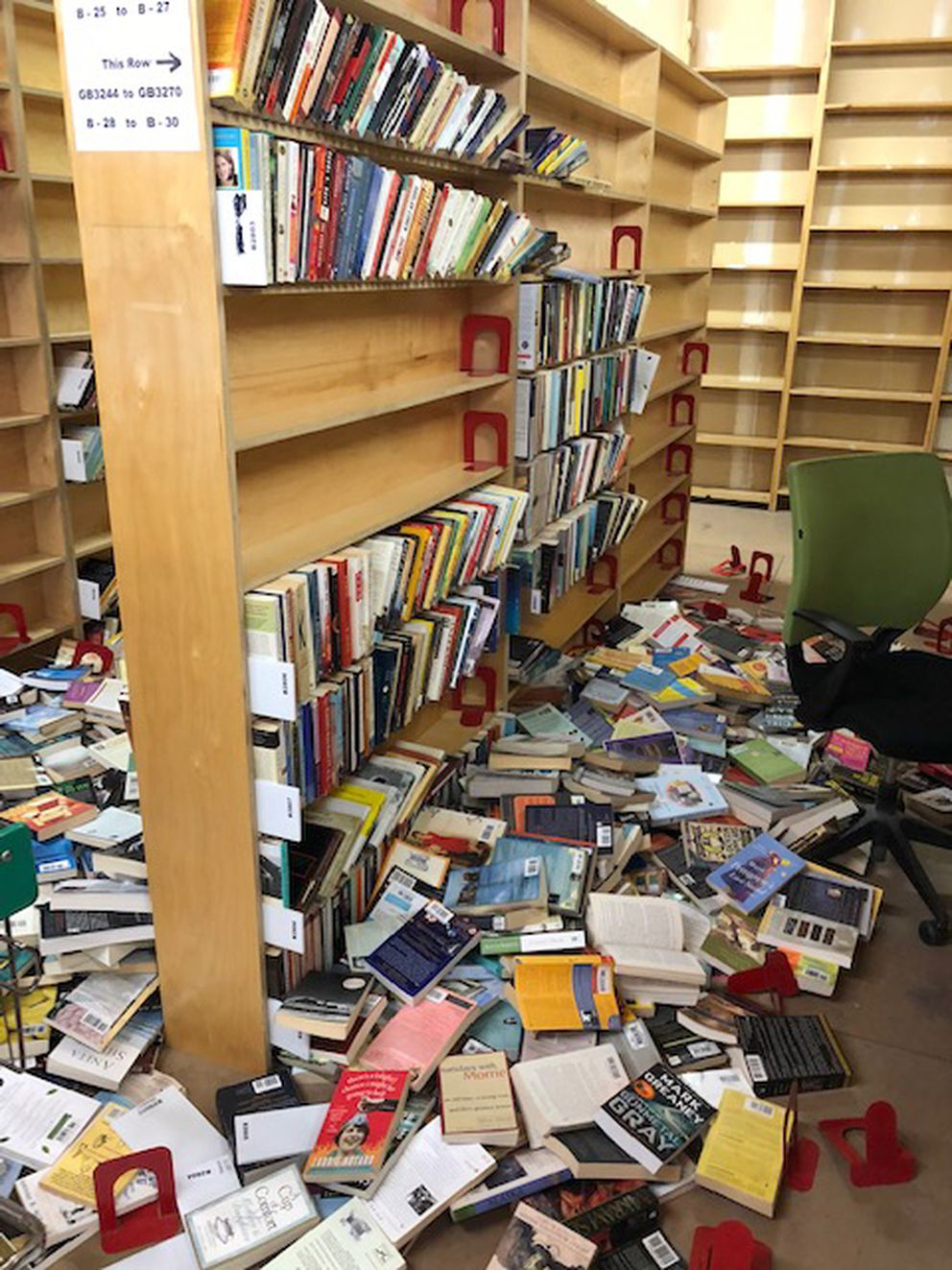 Upstairs warehouse of Title Wave Bookstore, after the earthquake shooks books off shelves, Nov. 30, 2018. (Photo by Elora Libal)