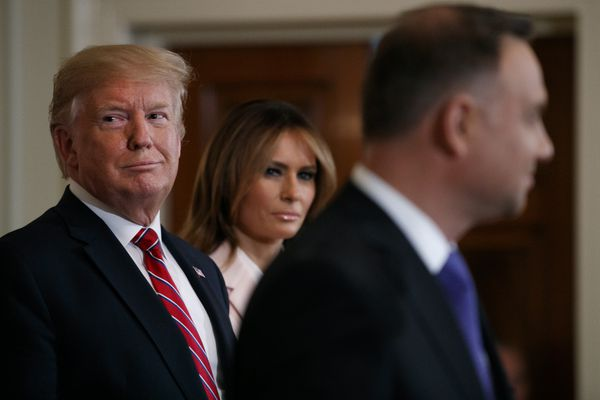 President Donald Trump and first lady Melania Trump attend a Polish-American reception with Polish President Andrzej Duda in the East Room of the White House, Wednesday June 12, 2019. (AP Photo/Jacquelyn Martin)