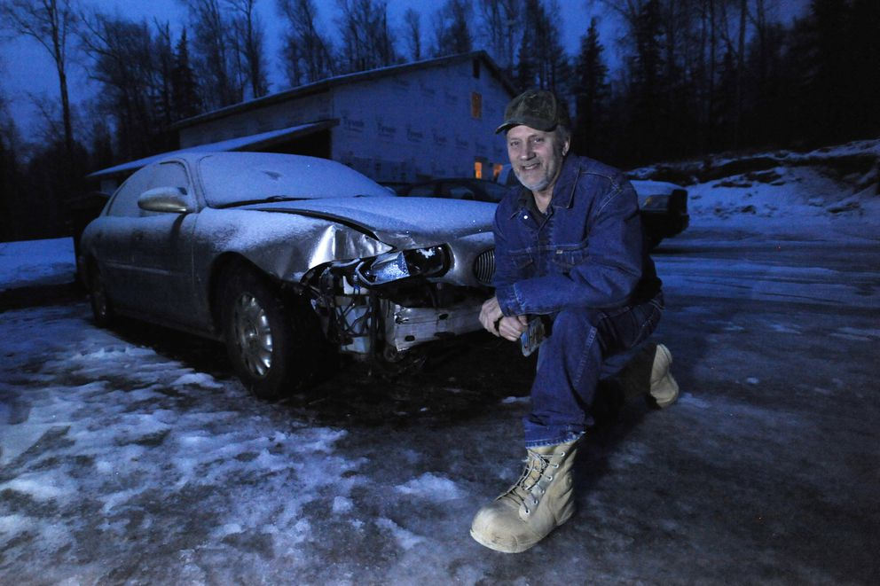 Joe Fedewa of Big Lake was driving his 2000 Buick Le Sabre northbound on Vine Road in the dark when the 7.0 earthquake hit. Fedewa said, 'the road kind of vanished and wasn't there anymore. ' His car was damaged by the event and became an icon of the quake in an aerial photograph published in the ADN. Monday, Dec. 3. 2018. (Bill Roth / ADN)