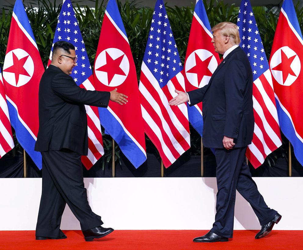 President Donald Trump and Kim Jong Un of North Korea greet each other before their meeting on Sentosa Island in Singapore, June 12, 2018. (Doug Mills/The New York Times)