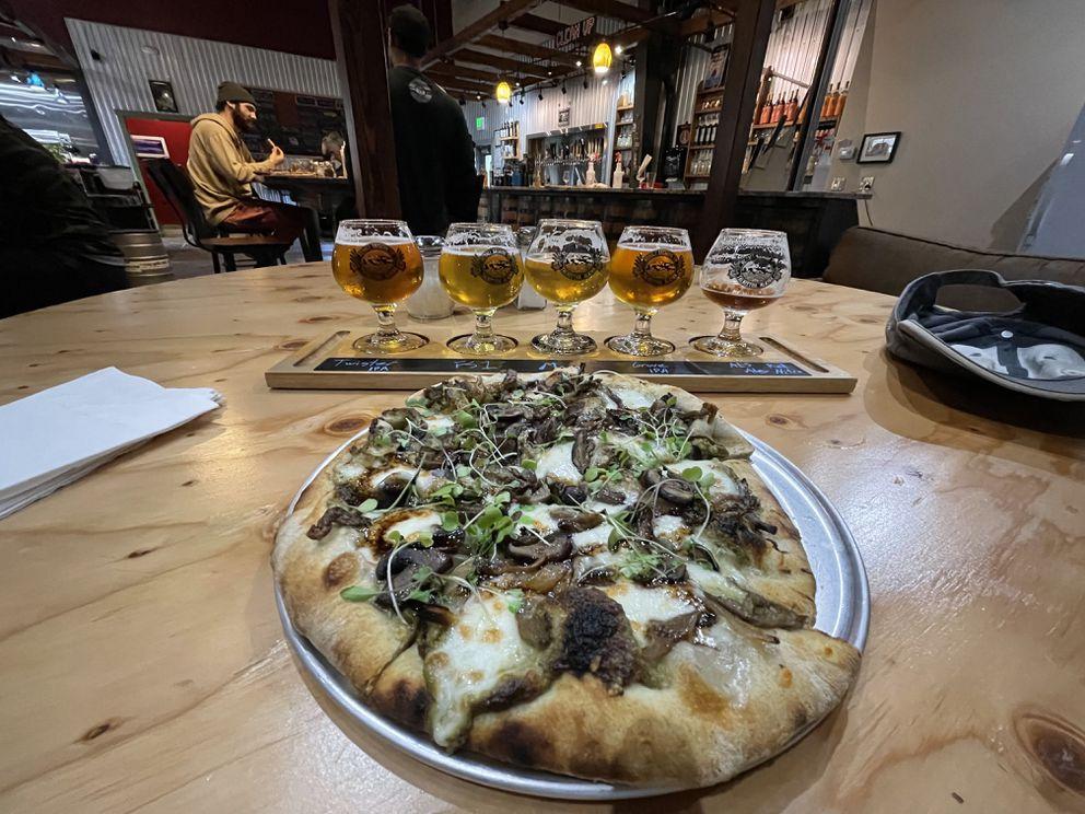 After a long bike ride, a flight of beer and a mushroom pizza from Denali Brewing in Talkeetna. (Scott McMurren)