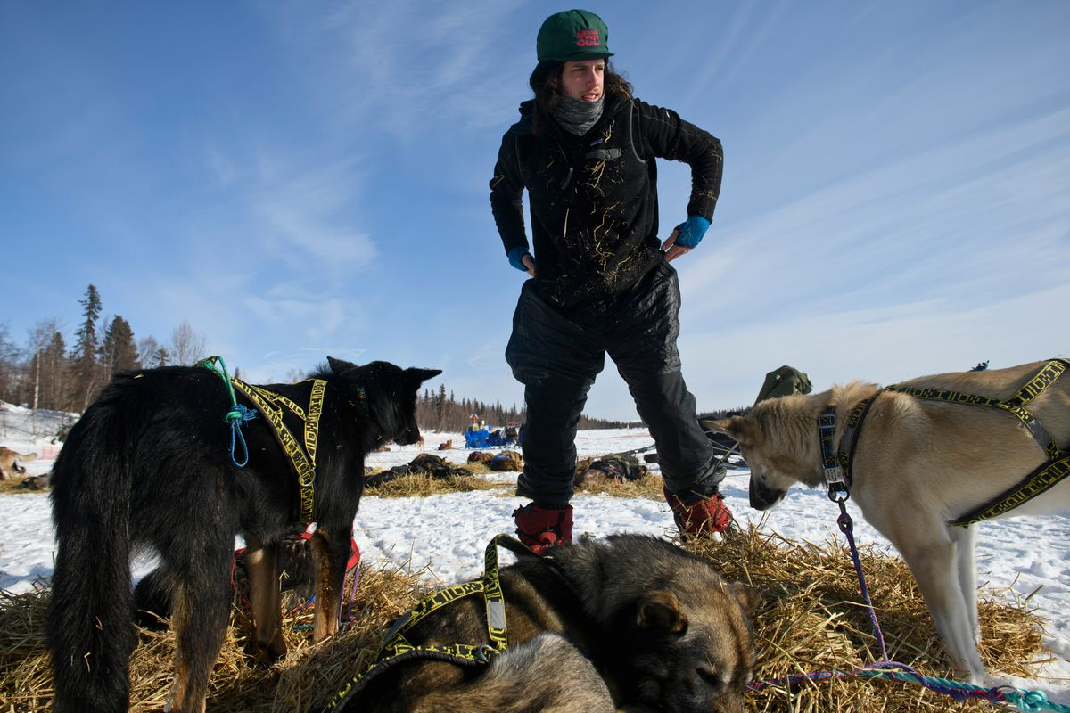 Sean Underwood parks his team at Finger Lake. He was among three mushers requesting assistance Friday after encountering deep overflow, race officials said. (Marc Lester / ADN)