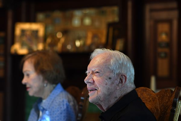 Former president Jimmy Carter sits next to his wife, Rosalynn Carter, while having dinner at the home of friend, on Aug. 04, 2018 in Plains, GA. MUST CREDIT: Washington Post photo by Matt McClain