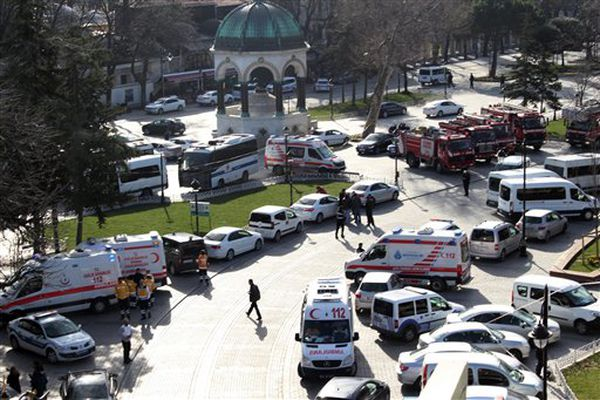 Rescue services vehicles are parked at the site of an explosion in the historic Sultanahmet district of Istanbul, Tuesday. The explosion killed 10 people and wounded 15 others Tuesday morning in a historic district of Istanbul popular with tourists.