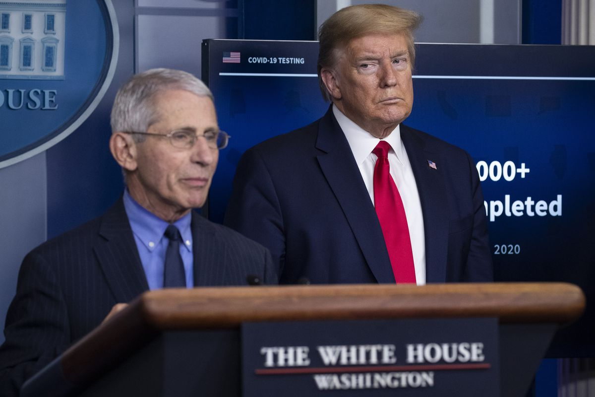 FILE - In this April 17, 2020, file photo Dr. Anthony Fauci, director of the National Institute of Allergy and Infectious Diseases, speaks about the coronavirus, as President Donald Trump listens, in the James Brady Press Briefing Room of the White House in Washington. (AP Photo/Alex Brandon, File)