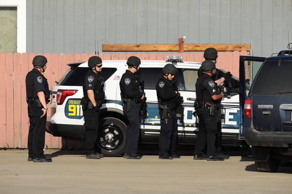 Anchorage police try to coax at least one burglary suspect out of a building on 13th Avenue in Anchorage on Tuesday, May 22. (Loren Holmes / ADN)