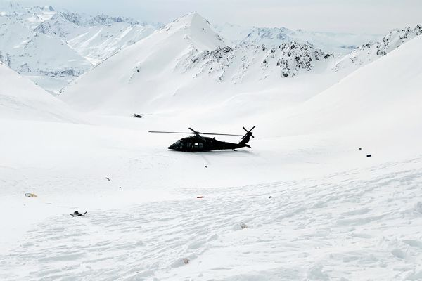 This photo provided by the Alaska Mountain Rescue Group shows an Alaska Army National Guard helicopter at the scene of a helicopter crash near Knik Glacier in Alaska on Sunday, March 28, 2021. Federal investigators say a helicopter carrying five passengers on a heli-skiing trip in Alaska crashed into a mountain and then rolled downhill nearly 900 feet. The pilot and four of the five passengers on board died in the crash, including billionaire Petr Kellner, the richest man in the Czech Republic. The National Transportation Safety Board is investigating the cause of the crash just north of Anchorage on Saturday night. (Lance Flint/Alaska Mountain Rescue Group via AP)