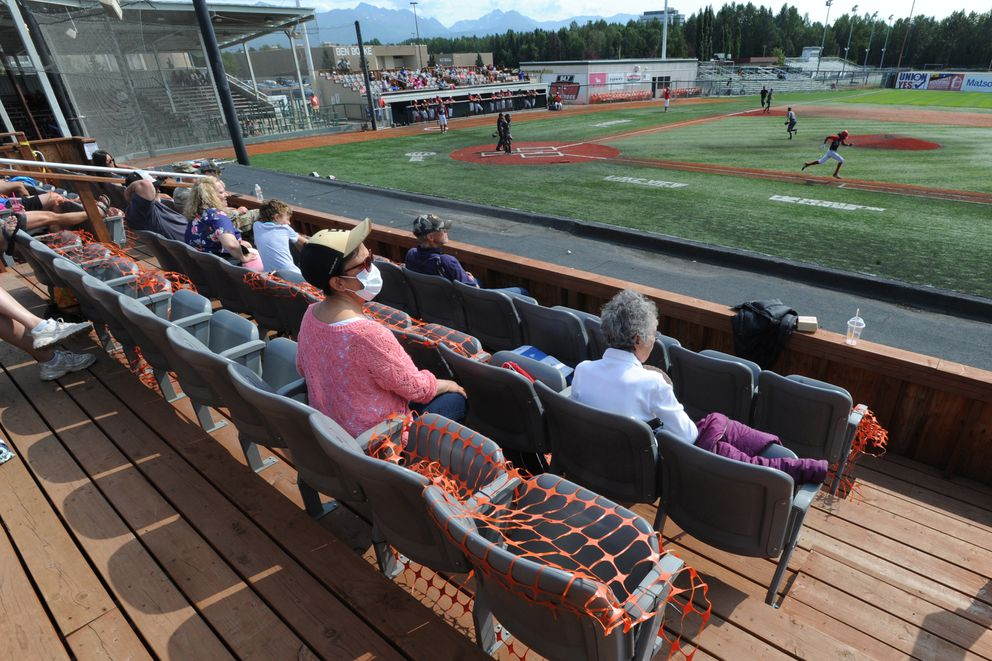 Orange fencing is being used to help keep social distancing for fans during the Alliance Baseball League state tournament at Mulcahy Stadium on Tuesday afternoon, July 28, 2020. The Wasilla Road Warriors defeated the South Wolverines 11-1 to advance to the state final. (Bill Roth / ADN)