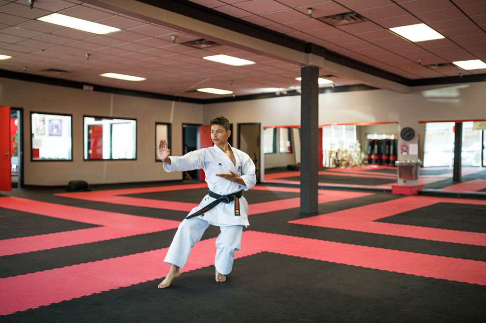 "Rickyjon Balgenorth practices the Kata Chatanyara Kushanku at Okamoto's Karate on July 31, in Anchorage. ""It's a way of life, the self-discipline,"" he said. ""… Karate is mainly about self-defense. You shouldn't use it just to beat people up. It's a lot about being humble."" (Loren Holmes / ADN)"