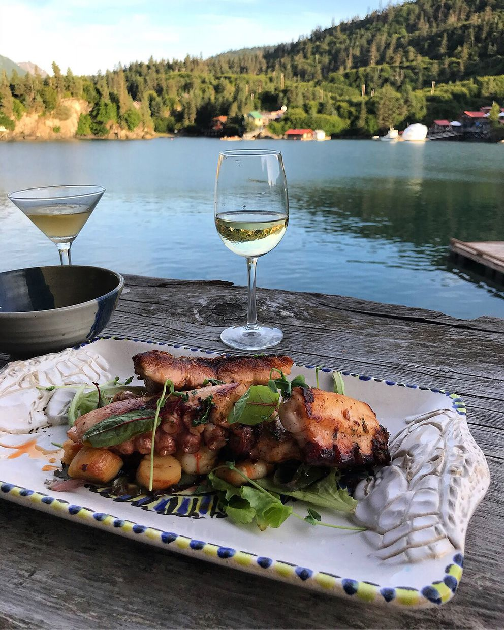 An off-menu Alaska seafood mixed protein plate at The Saltry in Halibut Cove, with octopus, king salmon, scallops, side stripe shrimp and a side of mussels. August 4, 2018. (Photo by Maya Wilson)