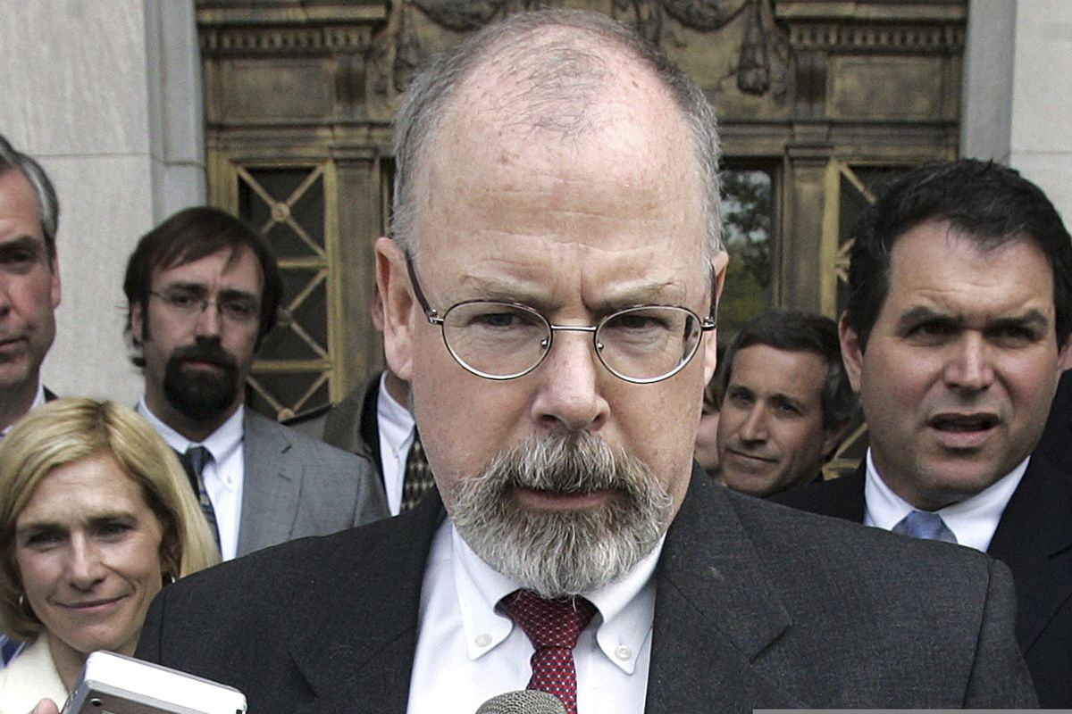 In this April 25, 2006, file photo, John Durham speaks to reporters on the steps of U.S. District Court in New Haven, Conn. (AP Photo/Bob Child, File)