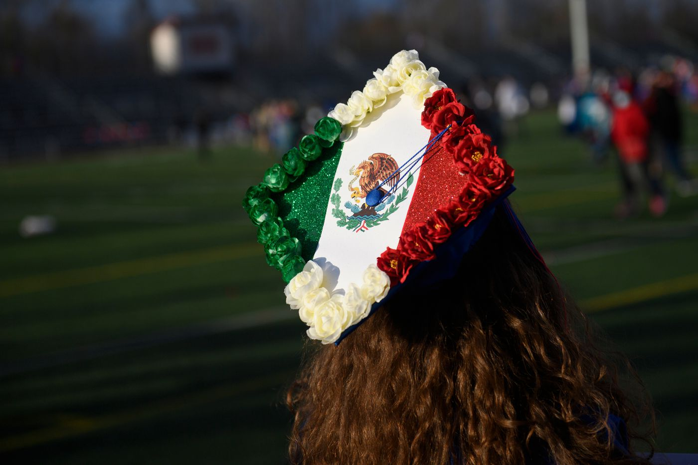 """Maricruz Gomez incorporated the Mexican flag on her East High School graduation cap. """"It means I made my parents proud, ' she said. (Marc Lester / ADN)"""