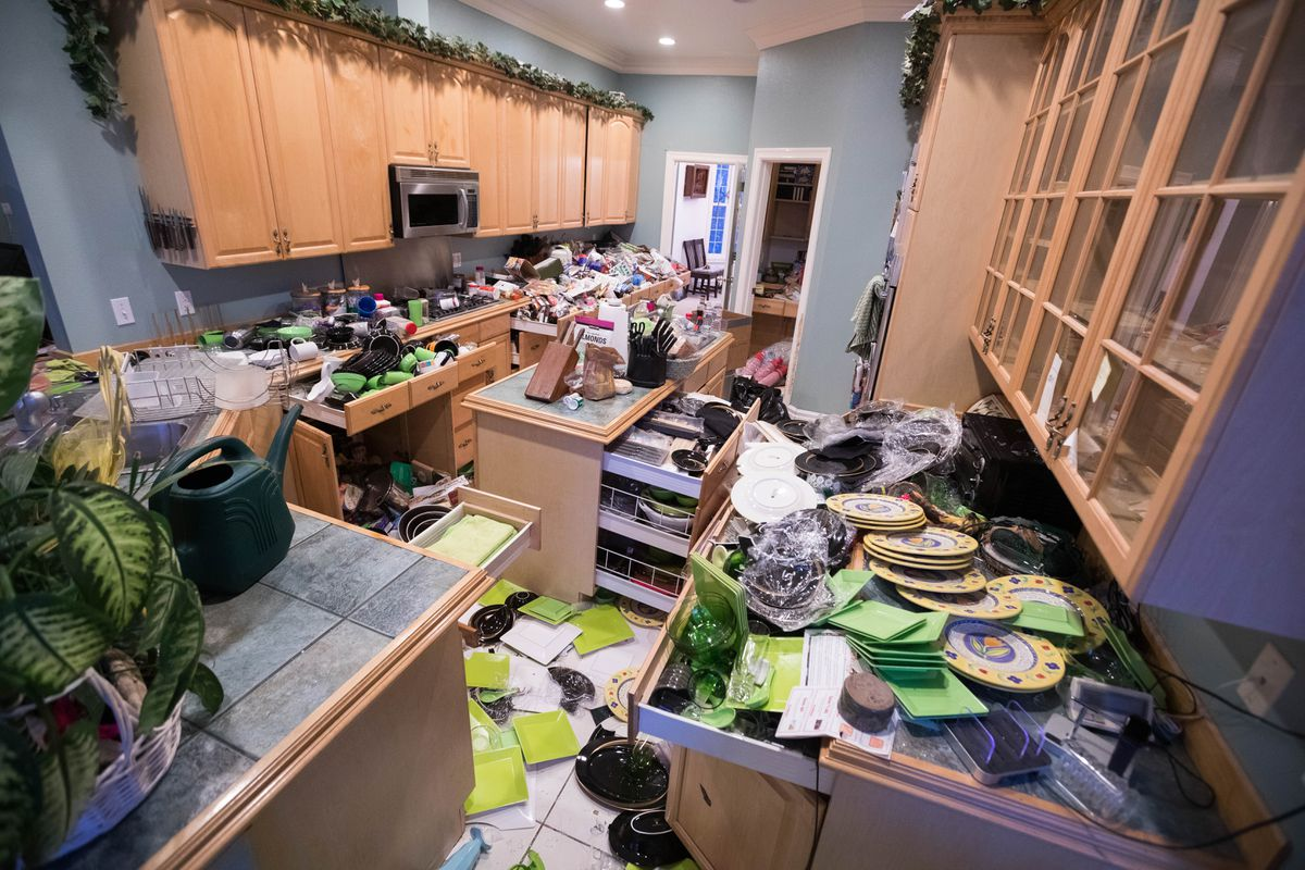 Judith Mahi's kitchen in Eagle River is covered with broken dishes and glassware, on Saturday morning, Dec. 1, 2018. Her house was badly damaged during a strong earthquake that shook southcentral Alaska on Friday. (Loren Holmes / ADN)