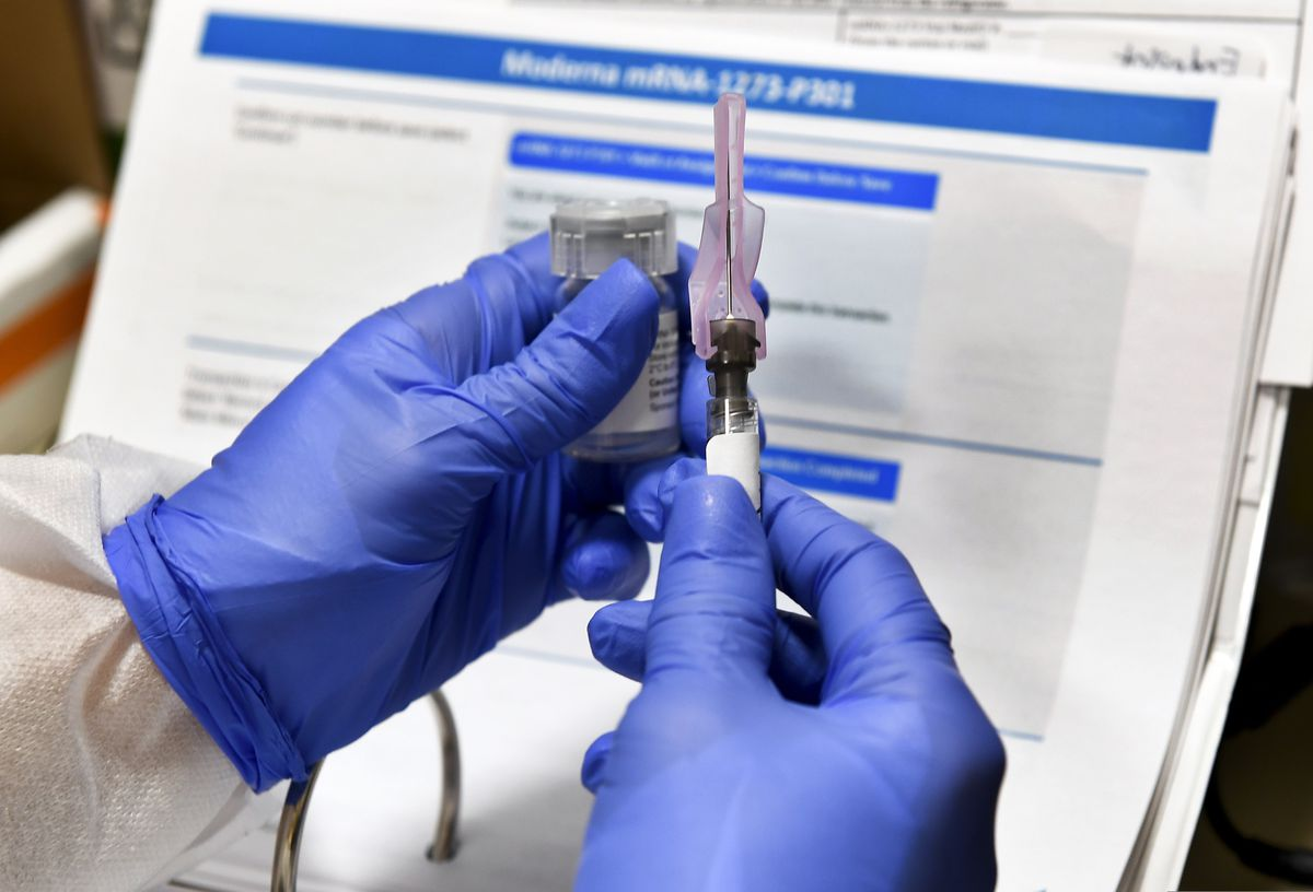 A nurse prepares a shot that is part of a possible COVID-19 vaccine, developed by the National Institutes of Health and Moderna Inc. in Binghamton, N.Y. (AP Photo/Hans Pennink, File)