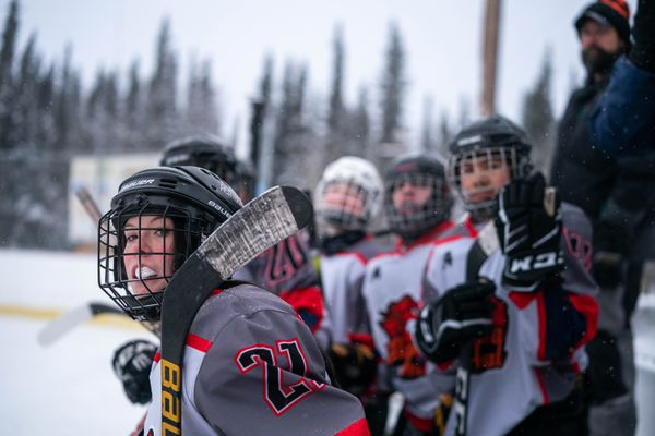 Alaska Heat forward Daykota Antrim watches the action during a game against the Monroe Catholic Rams Saturday, Feb. 1, 2020 during the Bold 'N Cold tournament at Glennallen High School. The school hosts games on their outdoor rink until the temperature dips below -20 Fahrenheit. (Loren Holmes / ADN)