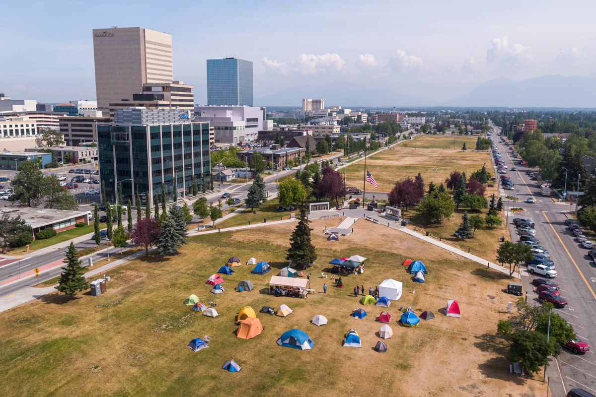 A group of campers protesting Gov. Mike Dunleavy's budget vetoes gather on the Delaney Park Strip Thursday, July 18, 2019. The city has posted notices informing the campers that the camps are illegal and must be removed by Friday. (Loren Holmes / ADN)
