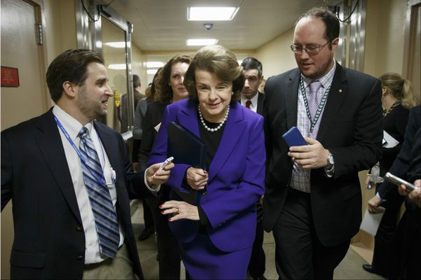 Senate Intelligence Committee Chair Sen. Dianne Feinstein, D-Calif. is pursued by reporters on Capitol Hill in Washington, Tuesday, Dec. 9, 2014, as she arrives to release a report on the CIA's harsh interrogation techniques at secret overseas facilities after the 9/11 terror attacks.