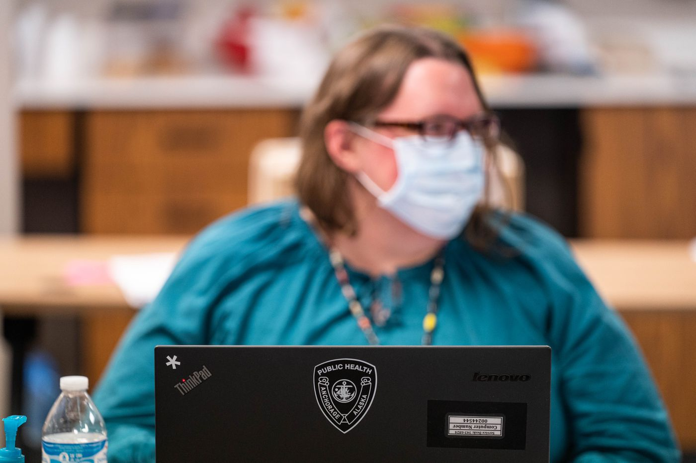 Anchorage Health Department nurse Amy Doogan works on the COVID-19 contact investigations and monitoring team on Thursday, April 16, 2020. The team is made up of nurses from the municipality as well as from the Anchorage School District. (Loren Holmes / ADN)