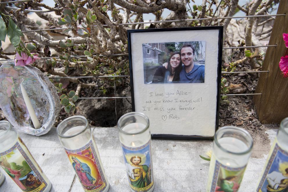 A photo left at a memorial for the victims of the Conception vessel reads 'I love you Allie - and you know I always Will! I'll miss you forever. Rob, ' placed at the Sea Landing at Santa Barbara Harbor in Santa Barbara, Calif., Tuesday, Sept. 3, 2019. Officials say no one likely escaped the flames that tore through a boat packed with scuba divers and the search for survivors has been called off. (AP Photo/Christian Monterrosa)
