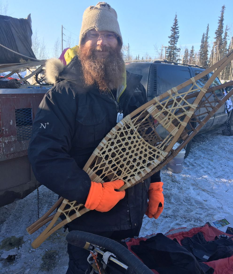 Iditarod musher Trent Herbst, a fourth grade teacher from Idaho, is carrying two snowshoes crafted by his students along the trail of the 2017 Iditarod. (Tegan Hanlon / Alaska Dispatch News)