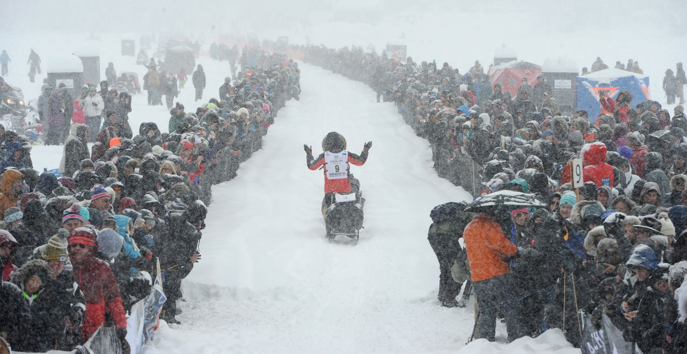 MARCH 8. Defending Iditarod champion Peter Kaiser of Bethel waves to the crowd gather on Willow Lake during the restart of the Iditarod Trail Sled Dog Race. (Bill Roth / ADN)