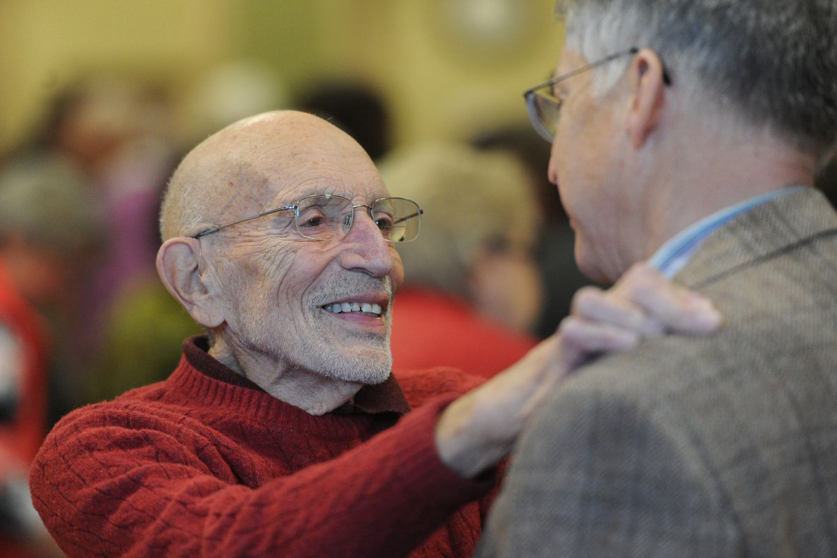 Vic Fischer, who served on the Natural Resources subcommittee at Gov. Bill Walker's transition conference, greets co-chair Rick Halford at UAA on Sunday, Nov. 23, 2014.