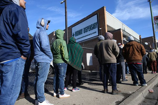 On the second day of legal recreational cannabis sales, people line up outside the Midway Dispensary in Chicago, on Jan. 2, 2020. (Antonio Perez/Chicago Tribune/TNS)