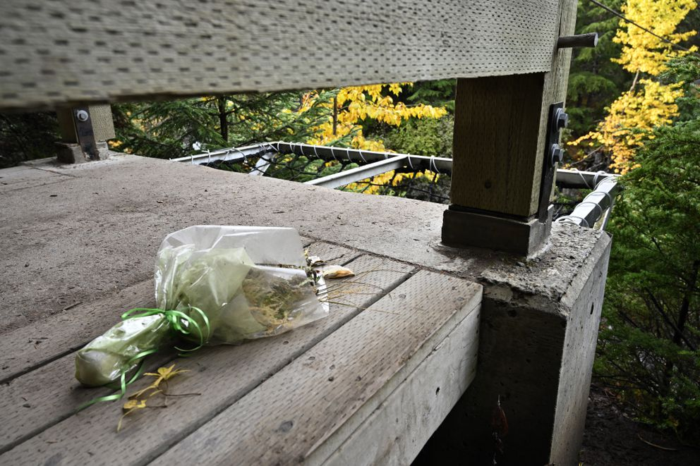 Flowers are left on a platform by the hand tram over Glacier Creek in Girdwood on October 5, 2019. A man died in June 2019 after a fall from the hand tram's platform. (Marc Lester / ADN)