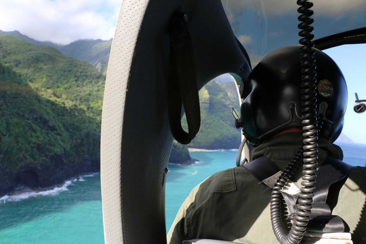 A Coast Guard search and rescue team looks over Napali Coast State Wilderness Park for a tour helicopter that disappeared in Hawaii with seven people aboard Thursday. (Dan Dennison/Hawaii DLNR via AP)
