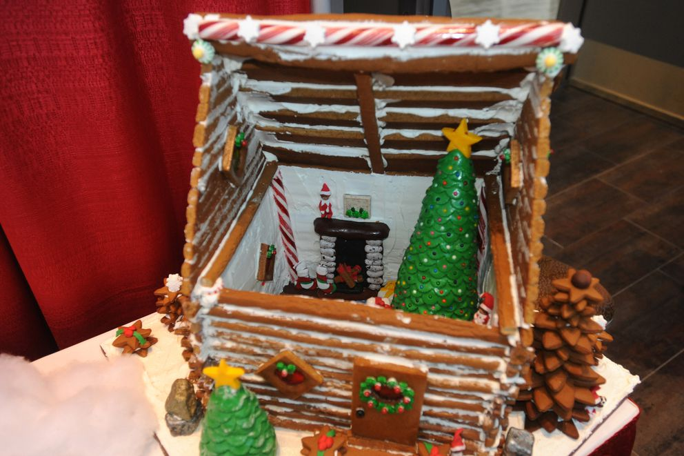 'Home Sweet Home ' by Chris Jett won third place at the gingerbread house competition and fundraiser for Habitat for Humanity - Anchorage, during the Christmas Arts & Crafts Emporium at the Dena'ina Center on Sunday, Nov. 24, 2019. (Bill Roth / ADN)