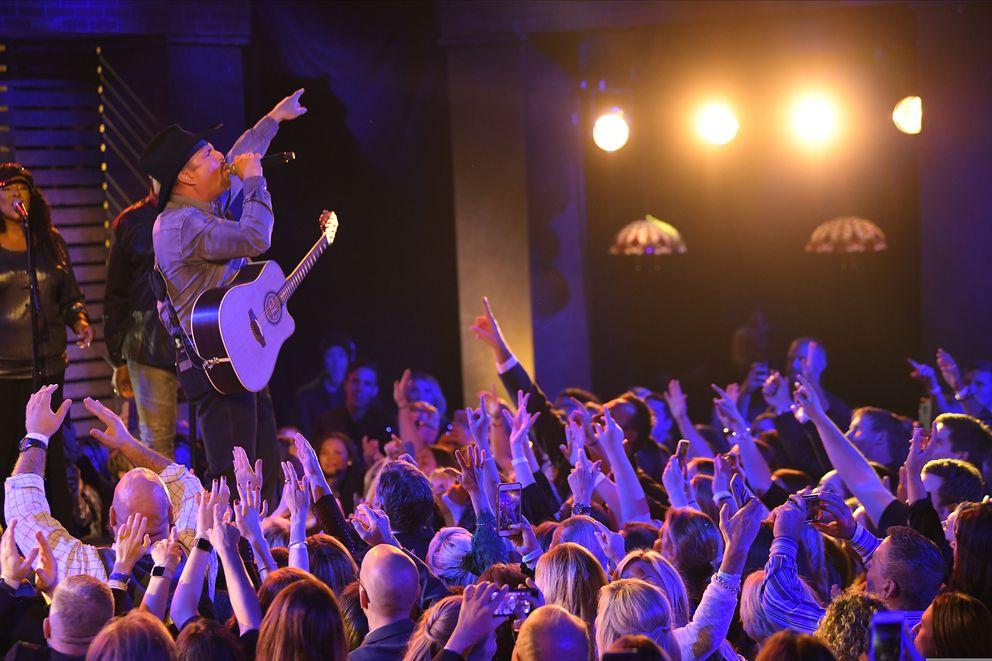 FILE - In this Nov. 13, 2019, file photo, Garth Brooks performs 'Dive Bar ' at the 53rd annual CMA Awards at Bridgestone Arena in Nashville, Tenn. (AP Photo/Mark J. Terrill, File)