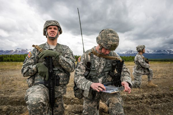 Soldiers from the Army's 4th Brigade, 25th Infantry Division participate in operation Spartan Reach at Joint Base Elmendorf-Richardson's Malemute Drop Zone on June 4, 2013. The operation was designed to simulate parachuting behind enemy lines and securing a hostile airfield. JBER is Alaska's biggest military base.