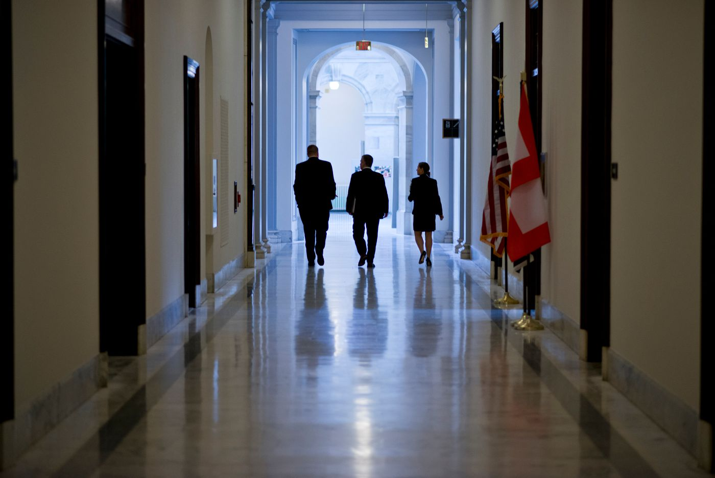 Sen. Dan Sullivan, center, walks the halls of the Russell Senate Office Building after a Commerce, Science and Transportation Committee meeting on Thursday, June 25, 2015. (Marc Lester/Alaska DIspatch News)