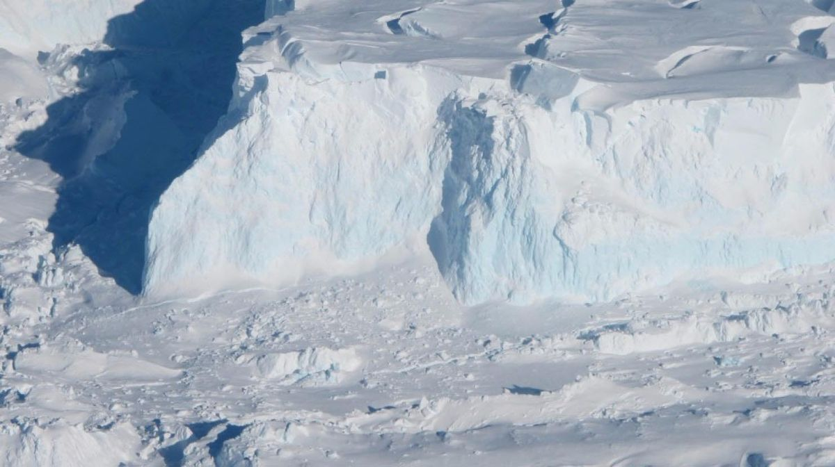 An edge of the Thwaites Ice Shelf in Antarctica. (NASA photograph by Jim Yungel)
