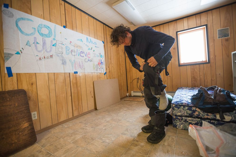 Joar Leifseth Ulsom wakes up from a nap during his mandatory eight-hour rest in White Mountain. (Loren Holmes / ADN)